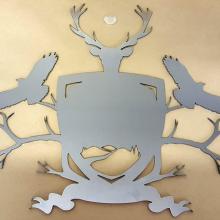 A fine detail, laser cut stainless emblem