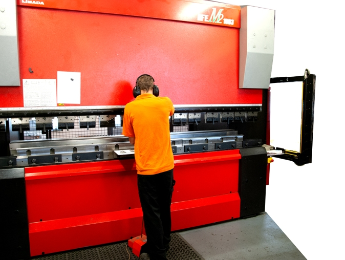 One of our skilled CNC press-brake engineers using Amada equipment