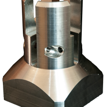 An aluminium milled and turned gripper head for a food packaging machine