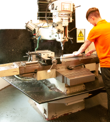 Our qualified machinist operating the manual equipment