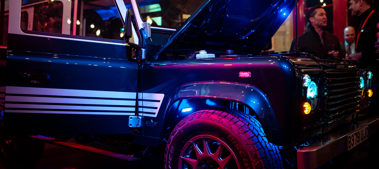 Revived-land-rover-in-spotlights-on-stage